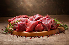 Fresh Meat With Rosemary On Wooden Board