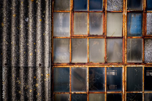 Photo Textures on old industrial window and corogated asbestos