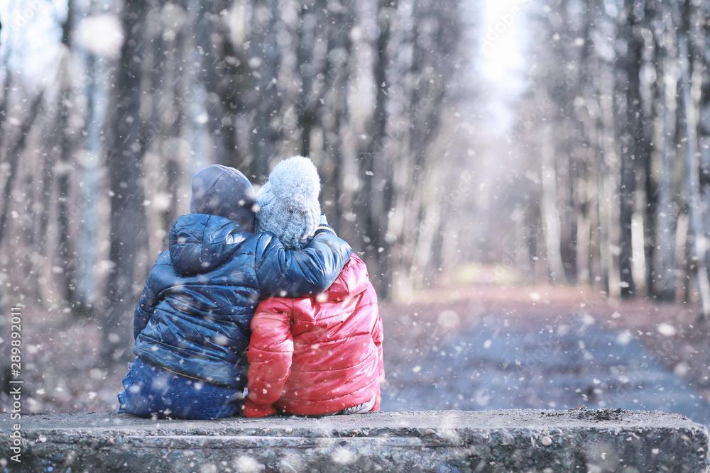 Fototapeta Kids walk in the park first snow