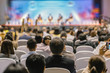 canvas print picture - Rear view of Audience listening Speakers on the stage in the conference hall or seminar meeting, business and education about investment concept