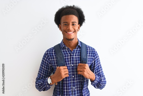 Photo  African american tourist man wearing backpack standing over isolated white backg