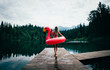 Leinwanddruck Bild Woman having fun with flamingo at lakeside place