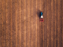 Aerial View Of Agricultural Tractor Doing Stubble Tillage