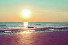 Sunset On The Beach. Tinted Photo In Golden Highlights. Sea And Sandy Beach. Banner, Long Format. Free Space For Text.