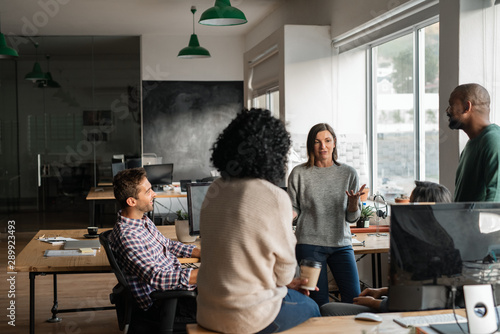 Diverse designers discussing a project together in their office