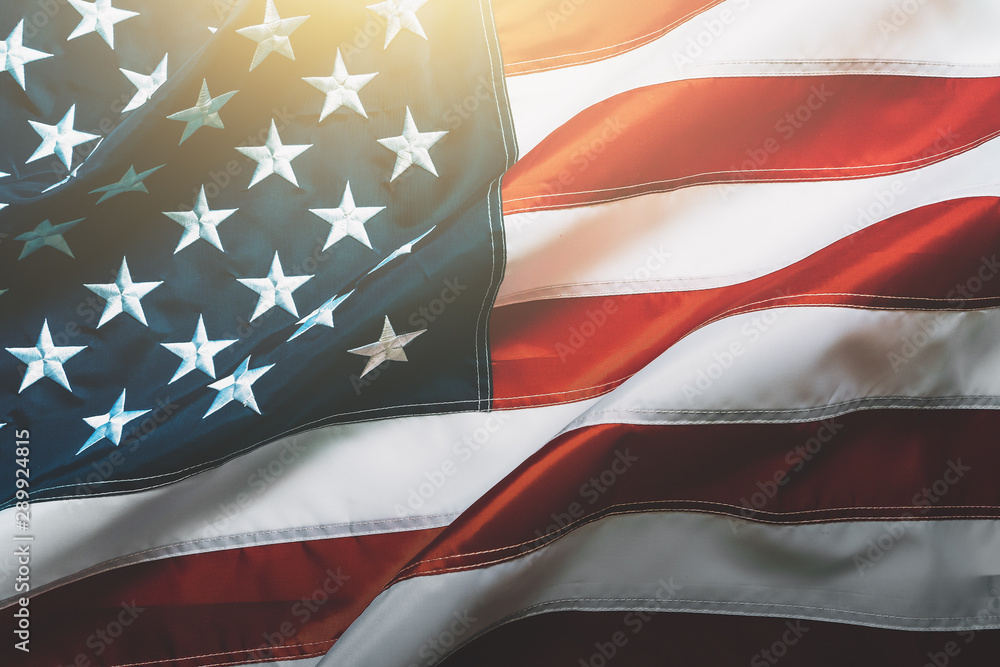 Fototapety, obrazy: USA flag background. Waving American flag in sunlight flare, close up