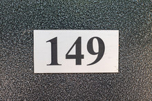 Number 149, One Hundred Forty Nine, Street Number Sign On The Wall