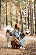 canvas print picture - Young Girl with her Dog, Alaskan Malamute, Outdoor at Autumn. Domestic pet