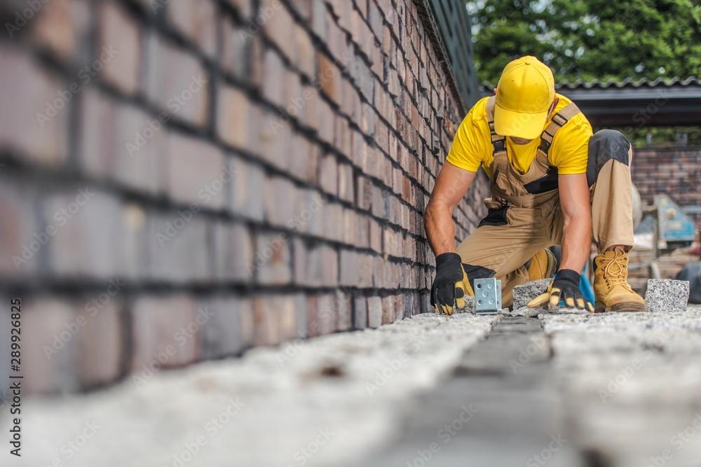 Fototapeta Granite Brick Paving Worker