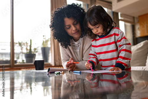 Obraz Loving mother and her adorable little girl coloring at home - fototapety do salonu