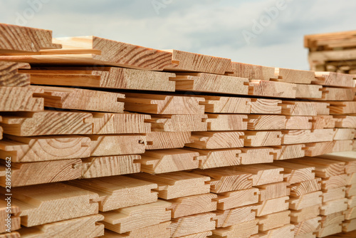 Obraz End view of stacked lumber. - fototapety do salonu