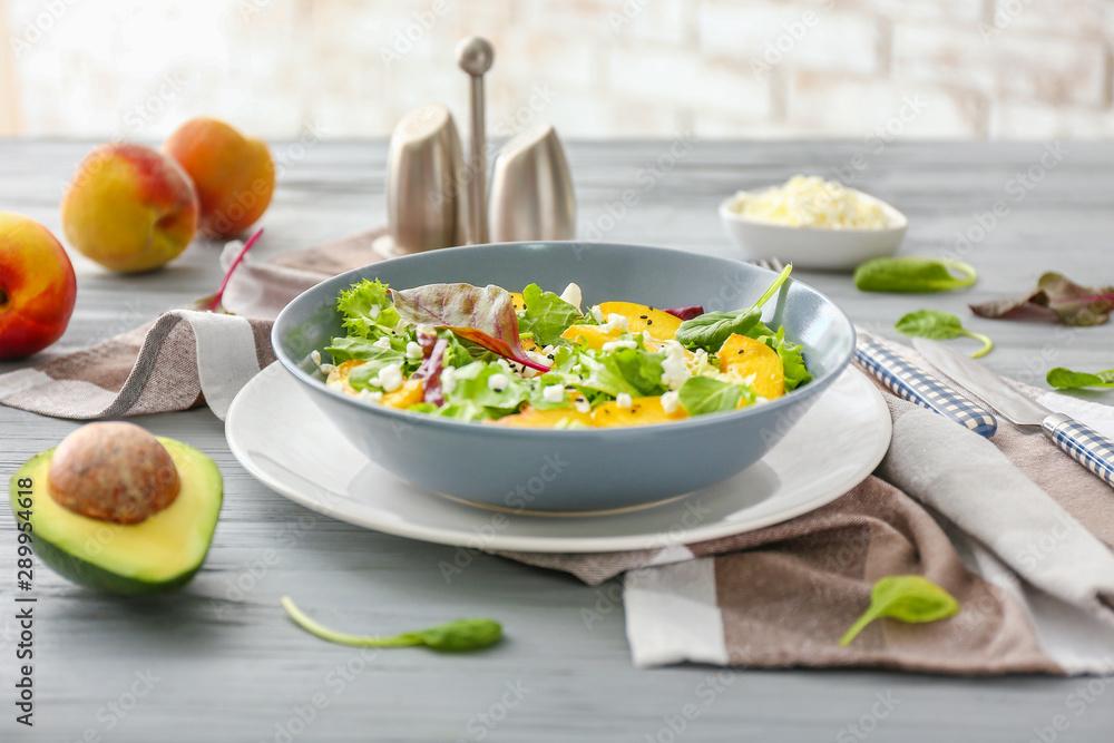 Fototapeta Plate with tasty salad on table