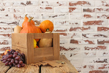 Wooden Box With Fresh Pumpkins, Squashes And Fruits On Table
