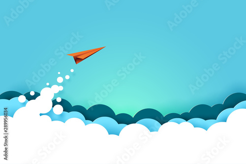 Stampa su Tela  Red paper airplane flying from clouds on blue sky background