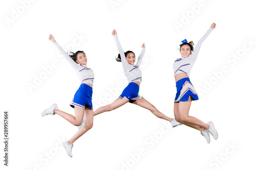 Cuadros en Lienzo  Group of cheerleader girls jumping together on studio
