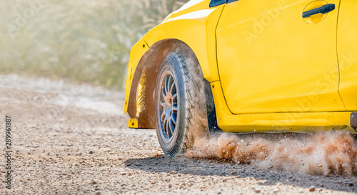 Fotomural  Rally racing car on dirt track.