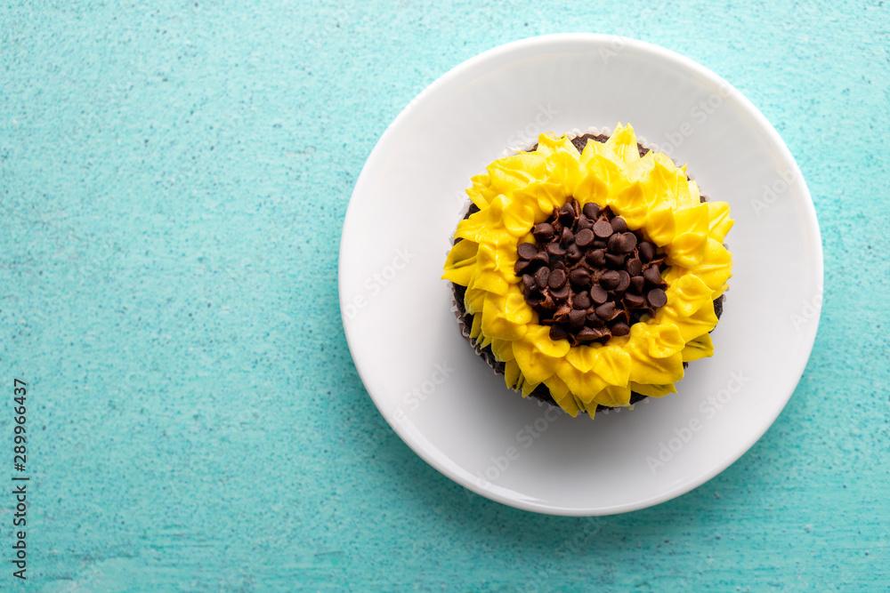 Fototapety, obrazy: Beautiful sunflower decorated chocolate cupcake on aqua pastel background