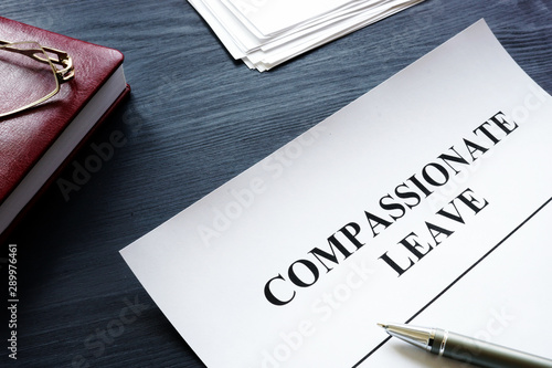 Compassionate leave request form with pen on the desk. Canvas-taulu