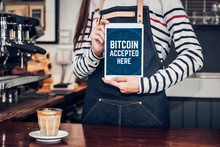 Close Up Woman Barista Holding Tablet And Show Bitcoin Accepted Here On Tablet Screen At Cafe Counter Bar,seller Coffee Shop Accept Payment By Crypto Currency.digital Money Concept.modern Waitress