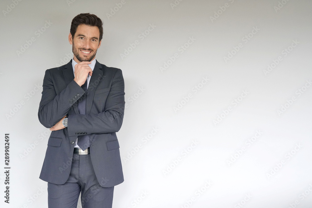 Fototapety, obrazy: Businessman standing on white background