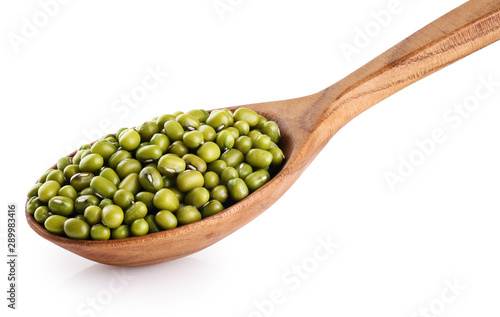 Wooden spoon with mung beans isolated on white background.