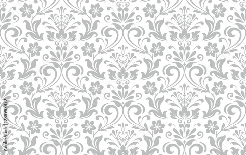 Floral pattern. Vintage wallpaper in the Baroque style. Seamless vector background. White and grey ornament for fabric, wallpaper, packaging. Ornate Damask flower ornament. - 289993472