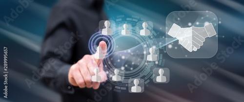 Fotografía  Man touching a business partner concept