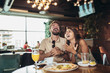 canvas print picture - Shot of a young happy couple eating pizza in a restaurant and having fun.