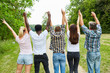 canvas print picture - Young people cheer together in the park