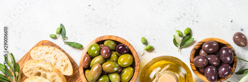 Poster Olijfboom Olives, ciabatta and olive oil on white background.