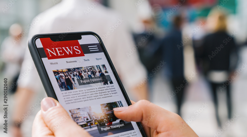 Leinwandbild Motiv - rcfotostock : Online news on a mobile phone. Close up of businesswoman reading news or articles in a smartphone screen application. Hand holding smart device. Mockup website. Newspaper and portal on internet.
