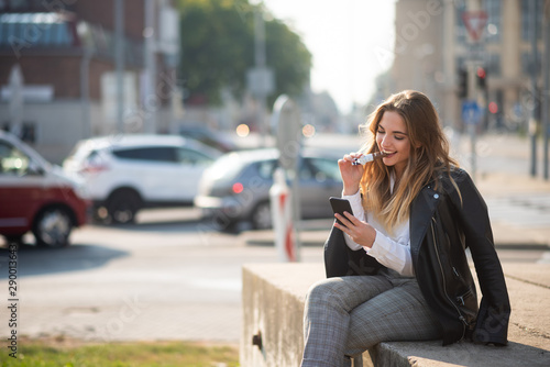 obraz PCV Woman with silky hair chatting on cell phone