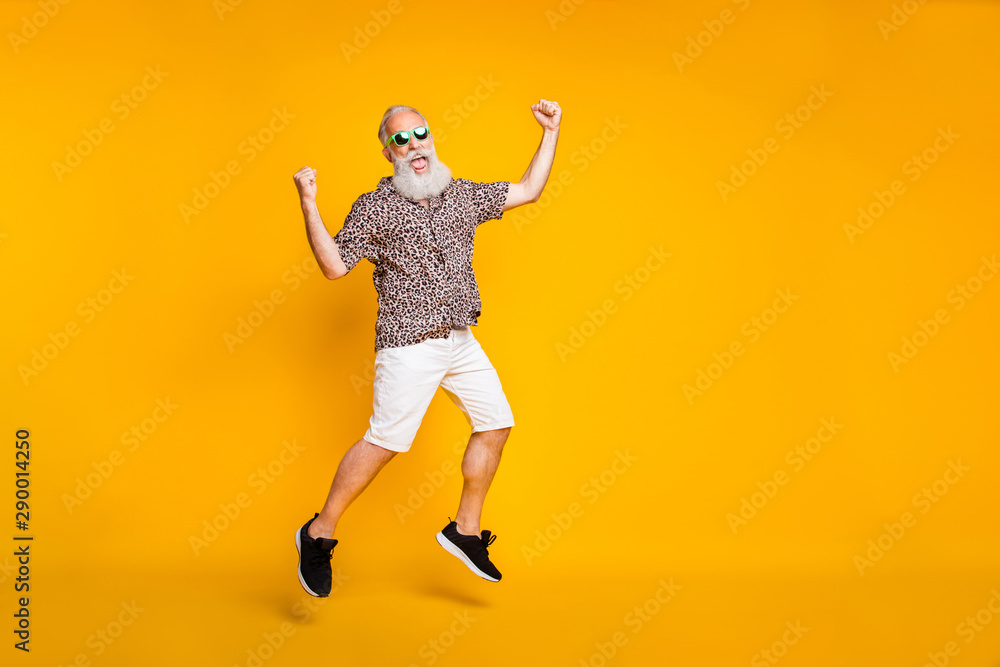 Fototapety, obrazy: Full length photo of funny funky lucky old bearded man in green eyewear eyeglasses raise fists scream yeah celebrate victory jump wearing leopard shirt shorts isolated over yellow background