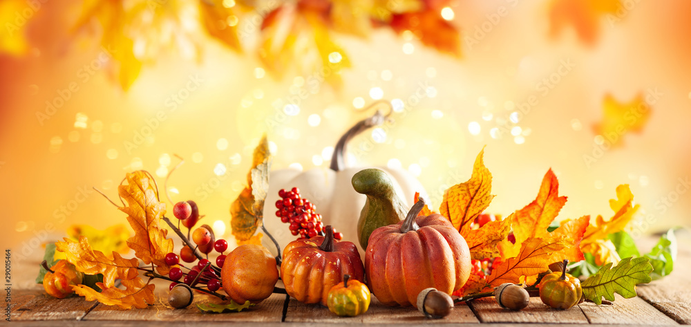 Fototapety, obrazy: Autumn background from fallen leaves and pumpkins on wooden vintage table. Autumn concept with red-yellow leaves background. Thanksgiving pumpkins.