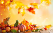 canvas print picture - Autumn background from fallen leaves and pumpkins on wooden vintage table. Autumn concept with red-yellow leaves background. Thanksgiving pumpkins.
