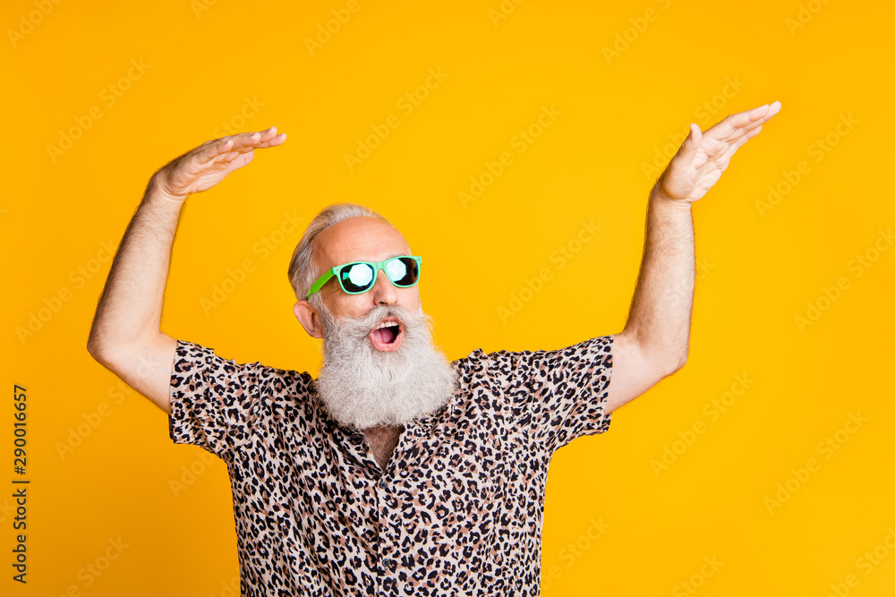 Fototapeta Photo of dancing cheerful rejoicing cool old man feeling young dancing in front of yellow vivid background he is isolated over