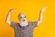 canvas print picture - Photo of dancing cheerful rejoicing cool old man feeling young dancing in front of yellow vivid background he is isolated over