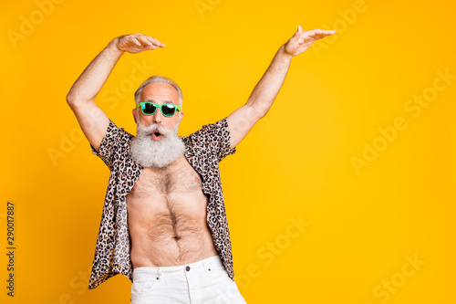 Photo of aged old man fooling still feeling young while isolated with yellow background - 290017887