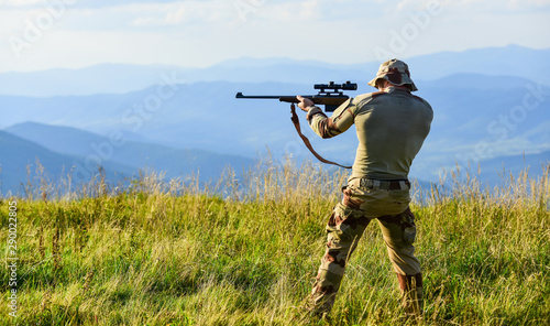 Poster Chasse Nice shot. Army forces. Hunter hold rifle. Hunter mountains landscape background. Focus and concentration experienced hunter. Man military clothes with weapon. Brutal warrior. Rifle for hunting