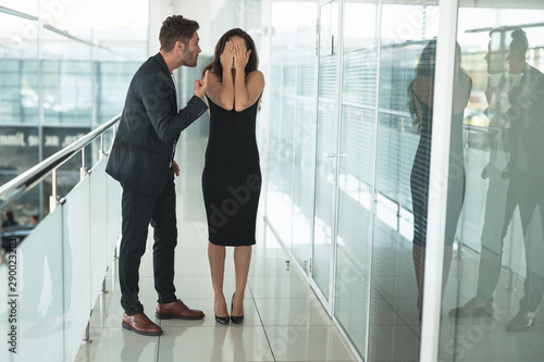 two colleagues man and woman having a professional argument at workplace Canvas Print