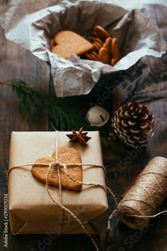 Rustic Christmmas present with gingerbread cookie