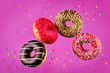 canvas print picture - Flying multicolored Donuts with sprinkles