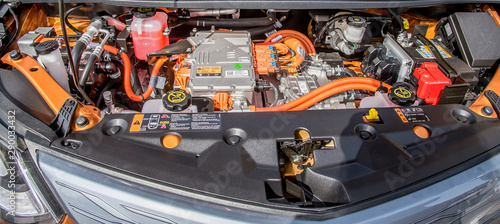 Fotomural  under the hood of an orange electric car, technology of the future
