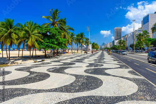 View of Copacabana beach with palms and mosaic of sidewalk in Rio de Janeiro, Brazil Canvas Print