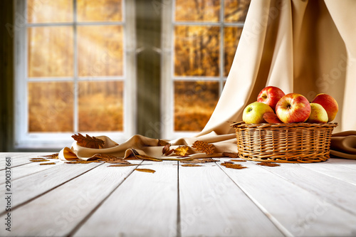 White wooden old window and autumn landscape of forest. Free space for your decoration on wooden table