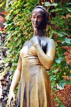 Bronze Statue Of Juliet Capulet In Her House Backyard. Courtyard Of Juliet's House In Verona, Veneto, Italy