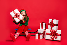 Nice Attractive Cheerful Cheery Glad Funny Pre-teen Elf Carrying Holding Fairy Miracle Cool Tradition Purchase Wish Christmastime Isolated Over Bright Vivid Shine Red Background