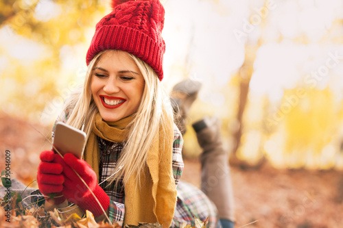 Cheerful girl calling on the phone outdoor - 290046009