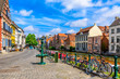 canvas print picture - View of embankment of Leie river in the historic city center in Ghent (Gent), Belgium. Architecture and landmark of Ghent. Cityscape of Ghent.