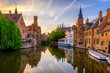 canvas print picture Classic view of the historic city center of Bruges (Brugge), West Flanders province, Belgium. Sunset cityscape of Bruges. Canals of Brugge